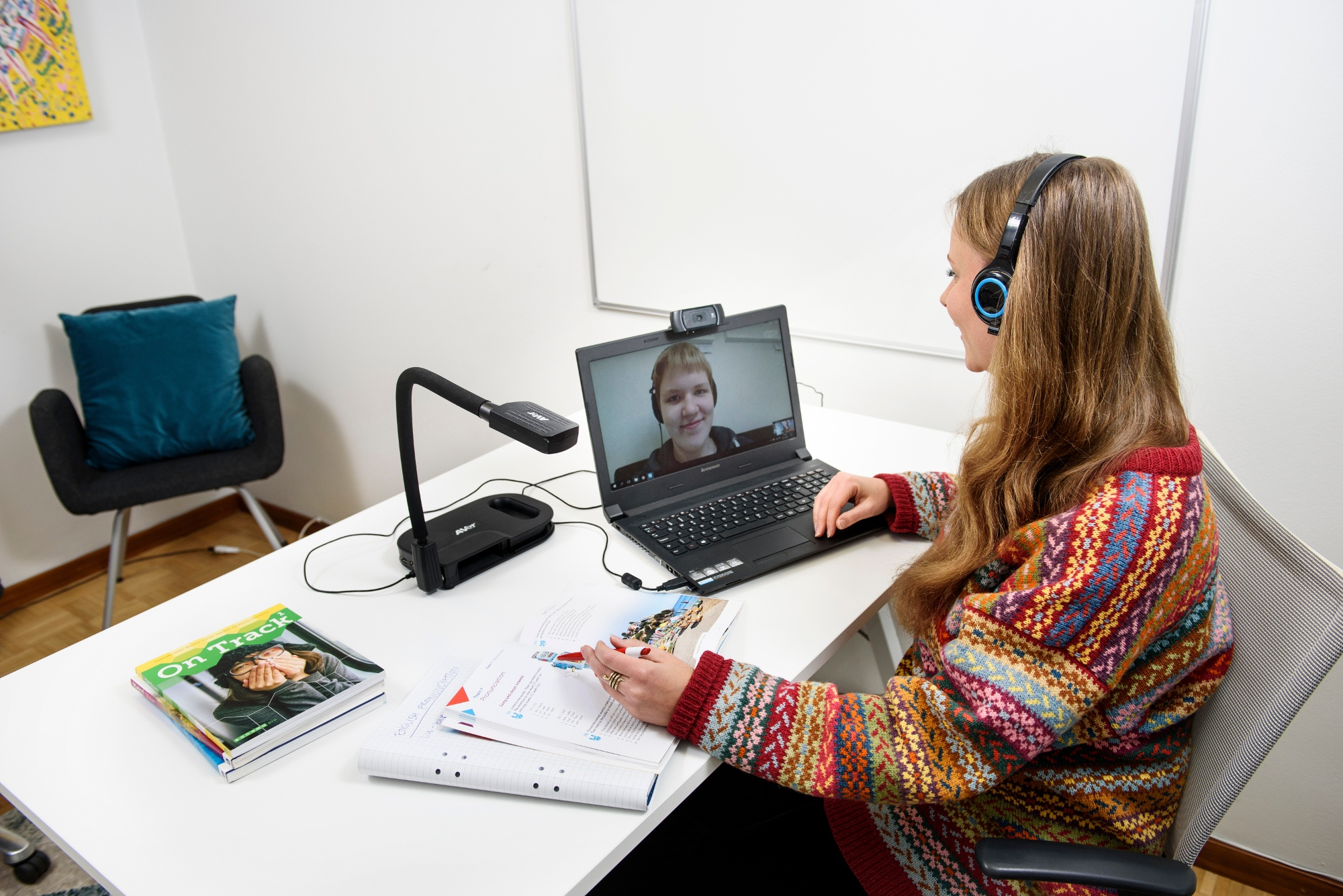 Female teacher teaching a teenage boy English via Skype.